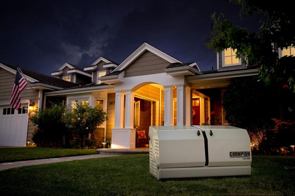 Champion residential generator in the foreground of a private, suburban home at night.