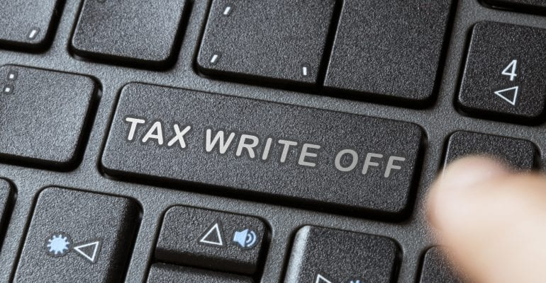 "Keyboard with phrase ""Tax Write Off"" on the return button for the CARES Act generator deduction."