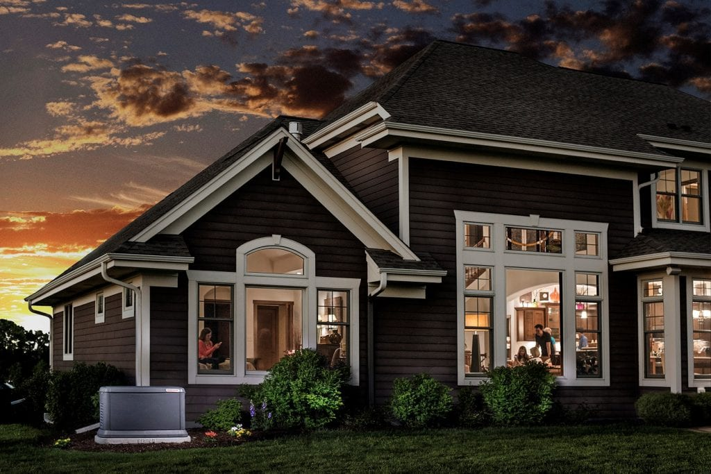 Large home at sunset with Honeywell generator installed for backup power.