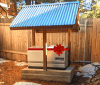 Champion Home Generator wrapped in a red Christmas bow as a holiday gift.