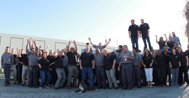 Duthie staff gathered together in celebration.