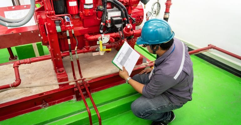 Engineer checking industrial generator fire control system, Diesel engine fire pump controller