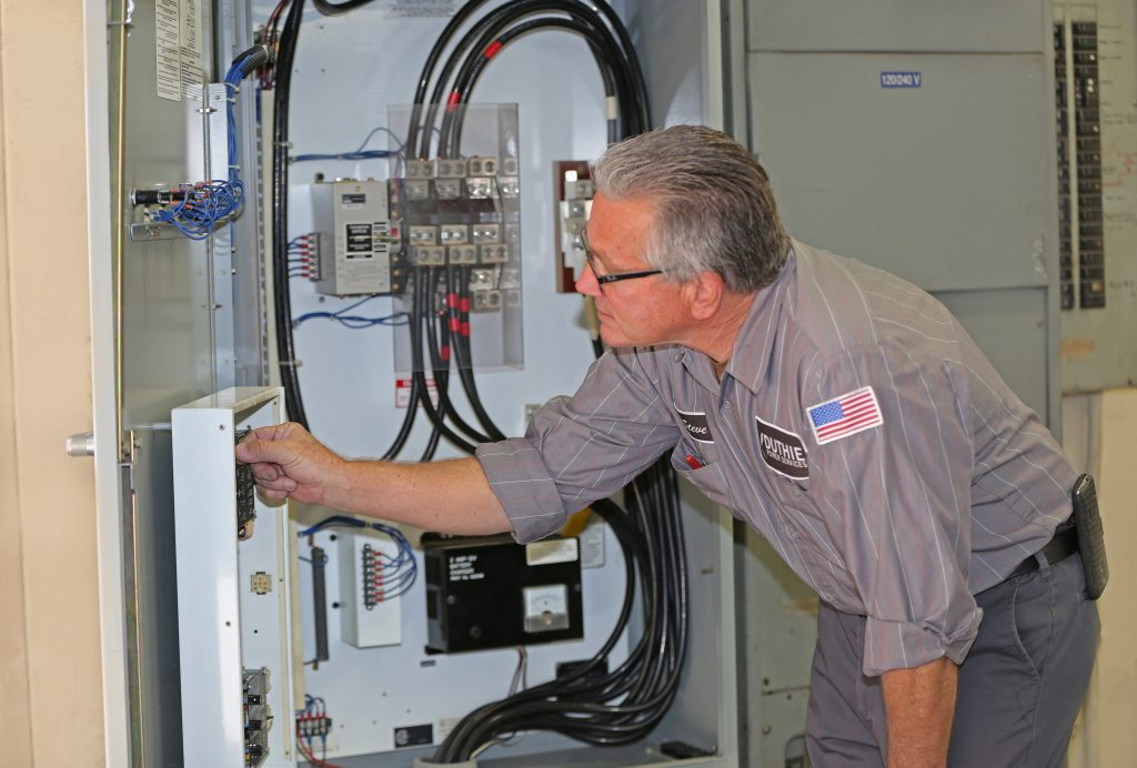 Duthie Power generator technician servicing an emergency power suppy system.